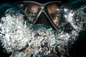 we are scuba divers splashing each other!